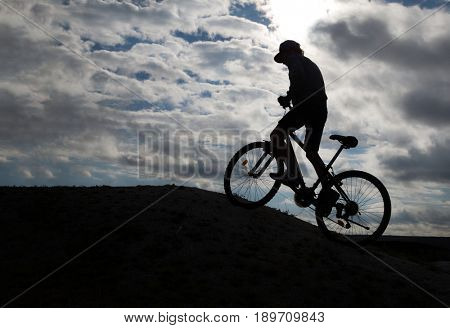 Silhouette of Mountain bike.Sport and healthy life.Extreme sports.Mountain bicycle and man.Life style outdoor extreme sport
