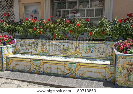 bench of ceramic tiles decorated with lemons and human figures, Capri island, Campania region, Italy, Europe