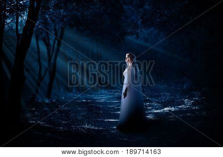 Young elven girl in forest