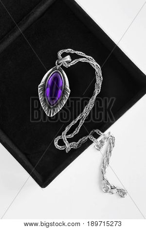 Vintage silver amethyst medallion in black jewel box