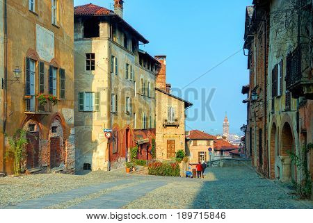Colorful classical Italian old fashion antique houses buildings architecture in Saluzzo. Italian painting ornaments architectural elements jalousie. Italian architecture. Italy holidays vacation tours