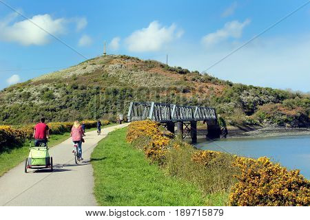 Camel Estuary, Cornwall, Uk - April 4 2017: Cyclists Approaching The Disused Iron Railway Bridge On