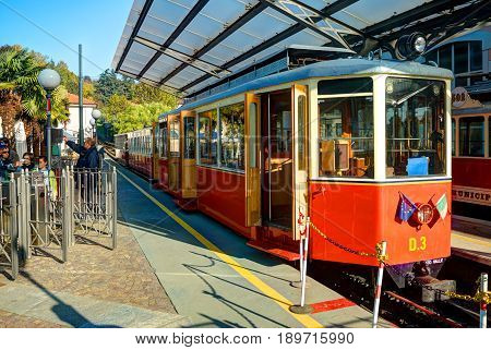TURIN, ITALY, OCT, 21, 2007: Italian mountain electric train to Basilica Di Superga church cathedral. Mountain train with gear red passenger coaches Alpine mountains. Italy holidays vacations tours