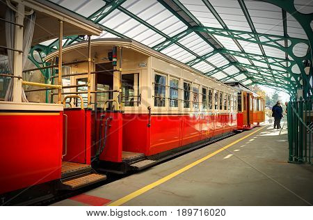 TURIN, ITALY, OCT, 21, 2007: Italian mountain electric train at rail way station Basilica Di Superga church cathedral. Mountain train passenger coaches Alpine mountains. Italy holidays vacations tours
