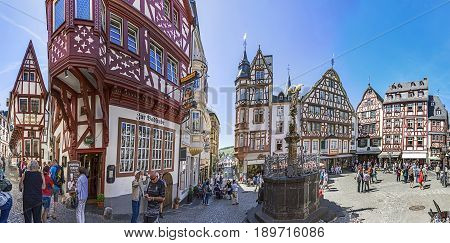 People Enjoy Visiting The  Old Historic Town Of Bernkastel-kues On A Summer Day