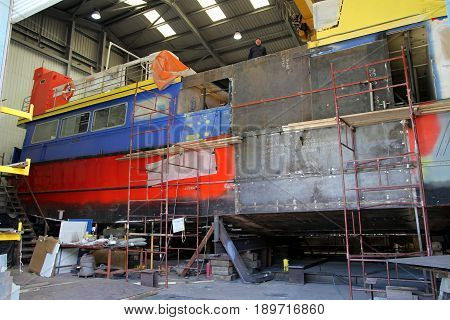 Padstow, Cornwall, Uk - April 6Th 2017: A Ferry Boat Being Repaired In Dry Dock In The Cornish Seasi