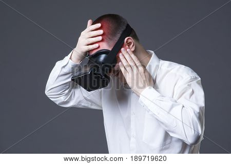 Vr pain headache and migraine after uses virtual reality glasses on gray background