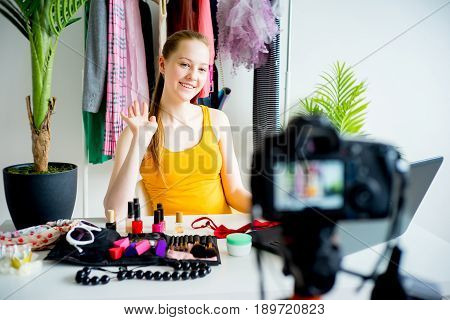 Female blogger making a makeup tutorial at office