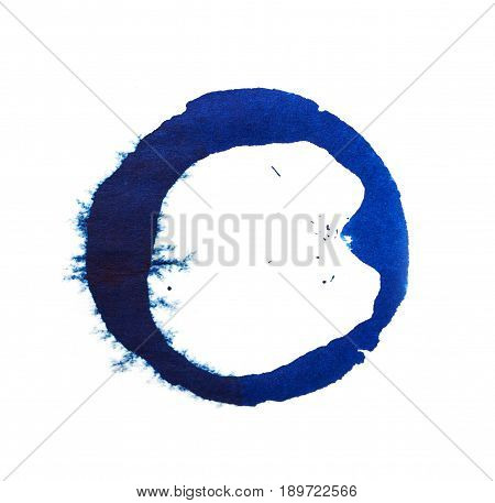 spot of blue ink on a white background