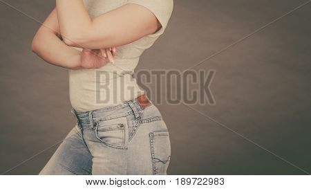 Woman wearing tight slim jeans and white tshirt showing her great body curves. Well-fitting pants