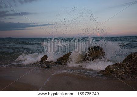 Stunning the raging sea waves at sunset