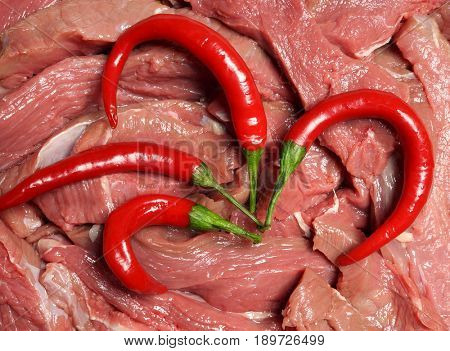 Meat and red pepper. Pieces of fresh meat