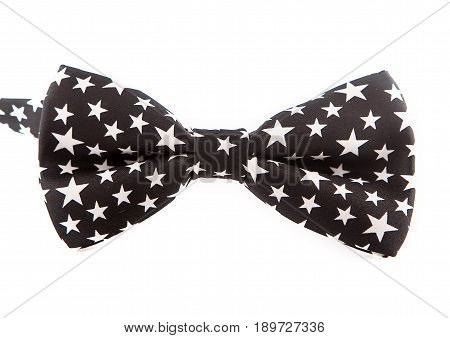 black bow tie with white stars on white background, nice for party, new year.