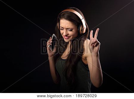 Beautiful Natural Emotional Dancing Young Woman Listening The Music, Showing V Sign By Hand In Wirel