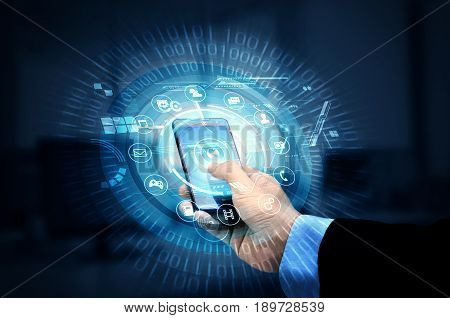 Businessman accessing internet interface on his smartphone