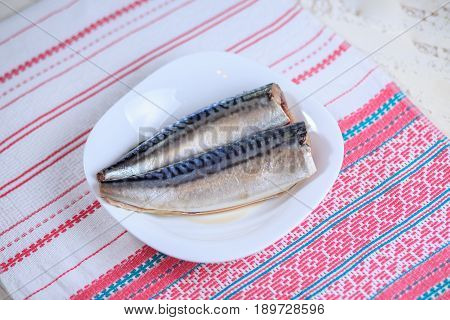 Brainless Crude Mackerel And A Tail On A Light Background