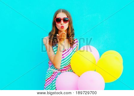 Beautiful Woman Blowing Lips Making Kiss An Air Colorful Balloons On A Blue Background