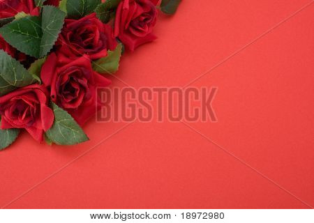 Red background with floral decor. Flowers are artificial.