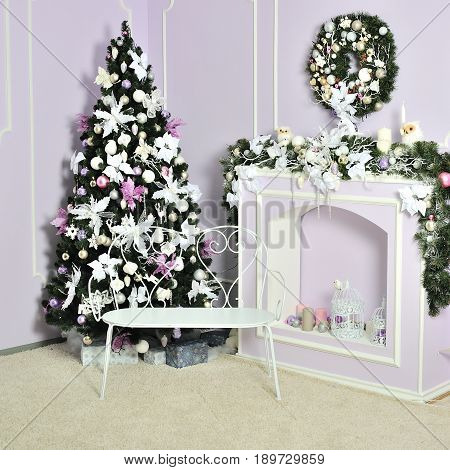 Decorated christmas and new year tree with gifts in a room near the fireplace