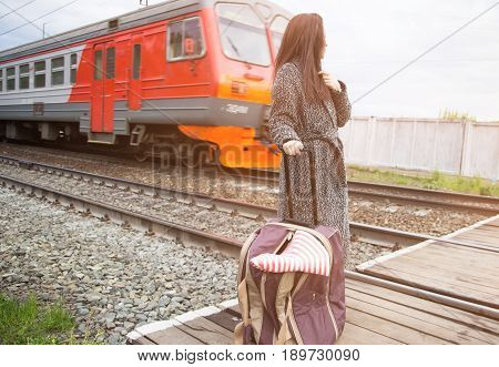 Girl With Bag At Station And Passing Train. Russian Railways