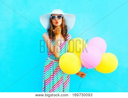 Fashion Woman Is Sends An Air Kiss Holds An Air Colorful Balloons On A Blue Background Wearing A Str