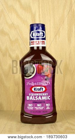 RIVER FALLS,WISCONSIN-MAY 05,2017: A bottle of Kraft brand strawberry balsamic vinaigrette with a wood background.