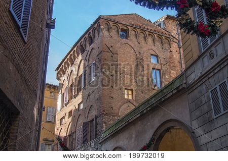 Italy Siena - December 26 2016: the view of the typical building of Siena on December 26 2016 in Siena Tuscany Italy.