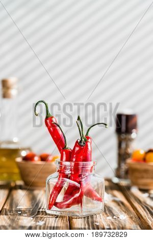 Red Chili Peppers On Wooden Table.
