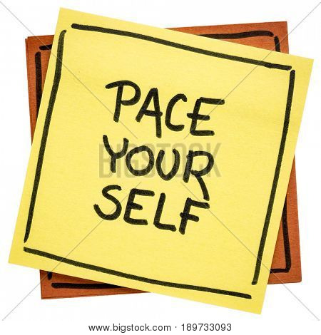 pace yourself reminder  - handwriting on an isolated sticky note