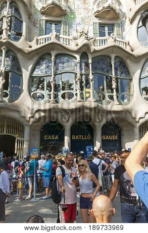 Tourists In Front Of The Casa Batllo, Designed By Gaudi. Barcelona, Spain