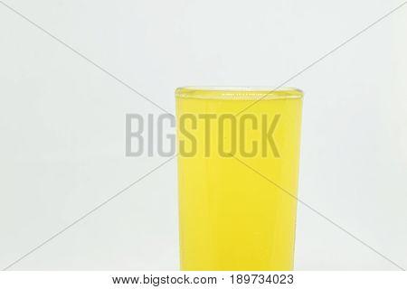 Close Up Orange Soda On White Background. Beverage Concept.