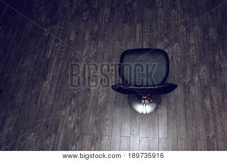 Vacant black bar chair top view on wooden surface with empty space