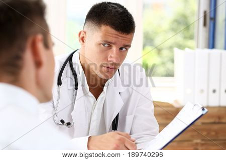 Concerned Handsome Doctor Communicate With Patient