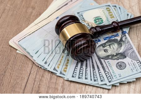 Law Mallet With Us Dollar On Wooden Surface.