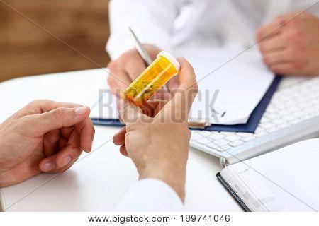 Male Medicine Doctor Write Prescription At Worktable