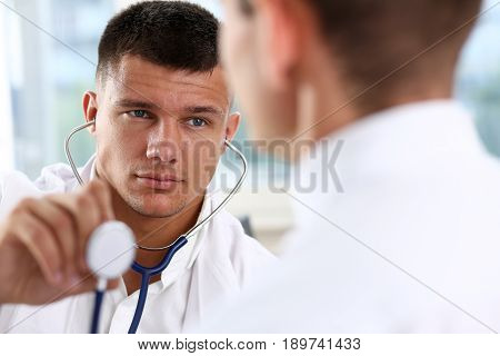 Handsome Smiling Male Doctor Hold In Hand Stethoscope Head