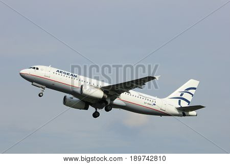 Amsterdam the Netherlands - June 2nd 2017: SX-DGN Aegean Airlines Airbus A320 taking off from Polderbaan Runway Amsterdam Airport Schiphol