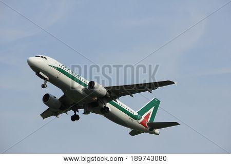 Amsterdam the Netherlands - June 2nd 2017: EI-IKU Alitalia Airbus A320-200 taking off from Polderbaan Runway Amsterdam Airport Schiphol