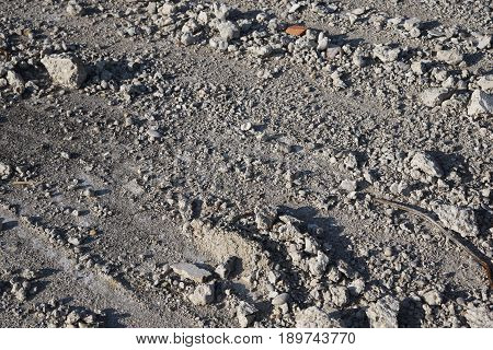 gray concrete rubble on the ground that was left there after demolition