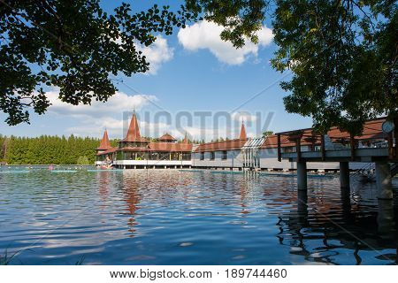Lake Heviz located in Hungary the wolrd 2nd largest natural warm water lake with foliage frame