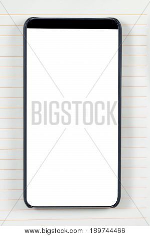 Bezel less smartphone with blank screen on a notepad background. Ready for mobile application mockup.