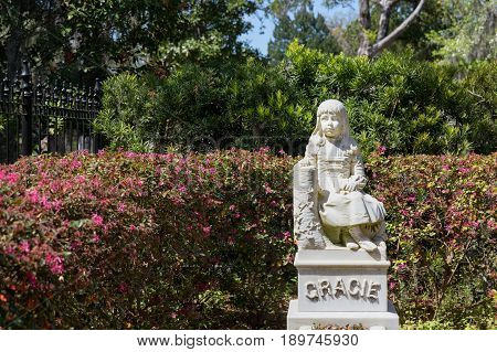 Little Gracie statue in historic Bonaventure Cemetery, Savannah Georgia. The life-size sculpture dates to 1889 and is a well-known Savannah tourist destination.