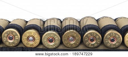 Tape with cartridges for hunting rifle concept on white background