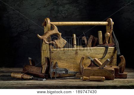 Still life - Old Wooden Tool Box Full of Tools