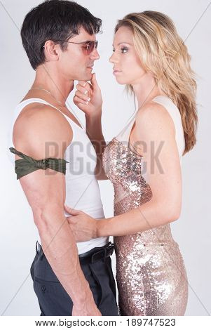 The army man is tempted to kiss a pretty woman.
