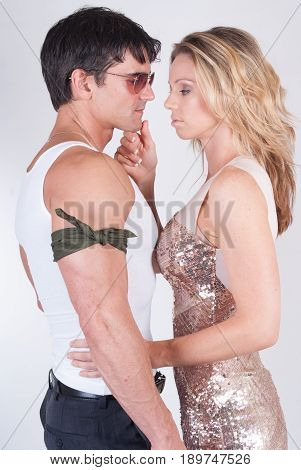 The mystery man is about to kiss a pretty lady.