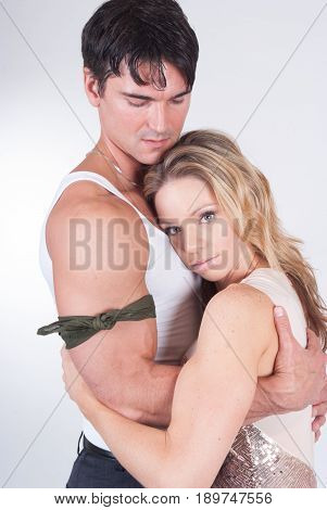The tough army man hugs his lady of love.