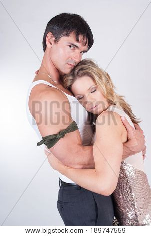 The cute sexy couple is in a loving pose.