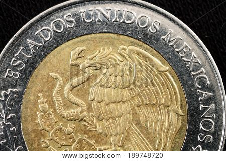 Super macro of a Mexican peso coin
