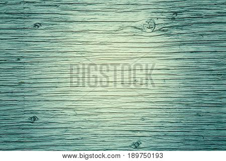 Wooden board planks fence with lines kinks curves texture background rough surface tender green yellow lime color copyspace for text